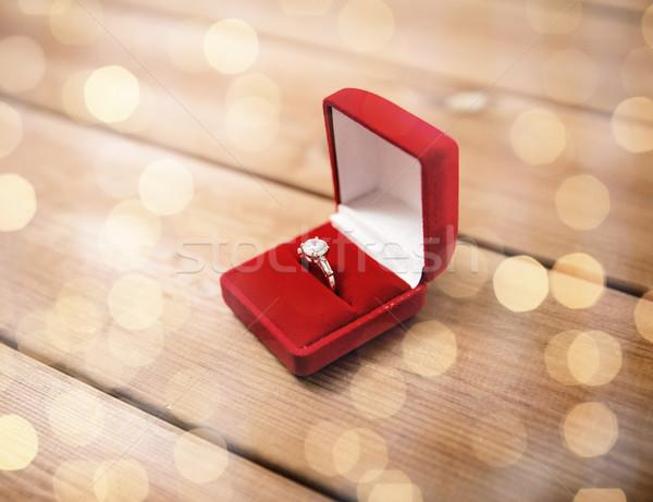 close up of gift box with diamond engagement ring Stock photo © dolgachov