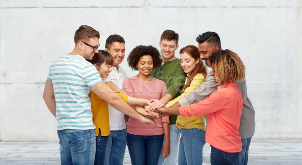 international group of happy people holding hands Stock photo © dolgachov