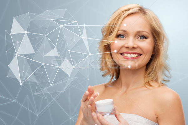 woman with moisturizer and low poly projection Stock photo © dolgachov