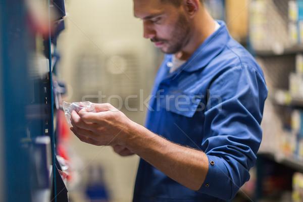auto mechanic or smith at workshop or warehouse Stock photo © dolgachov
