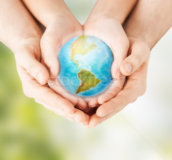 woman and man hands holding earth planet Stock photo © dolgachov