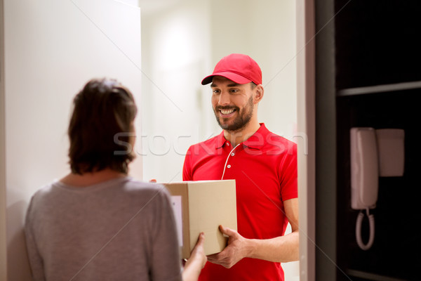 happy delivery man giving parcel box to customer Stock photo © dolgachov