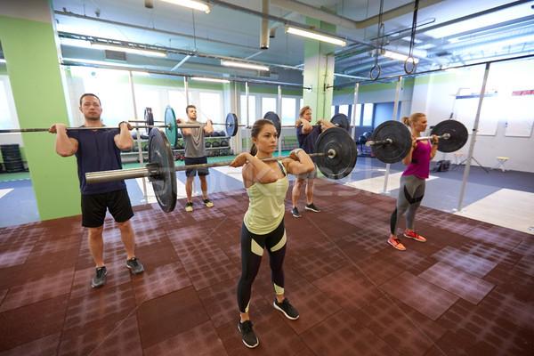 Groep mensen opleiding gymnasium fitness sport Stockfoto © dolgachov