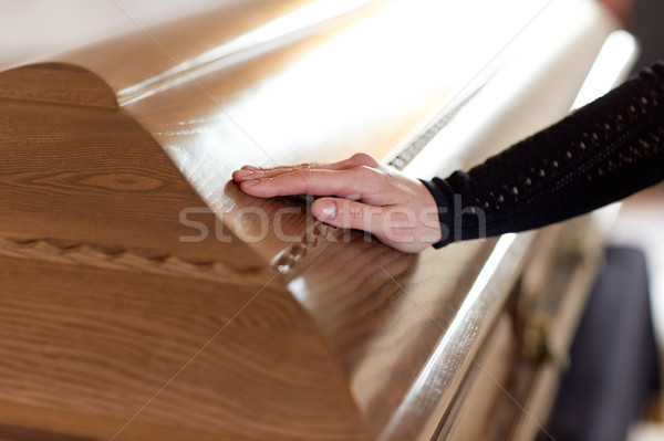woman hand on coffin lid at funeral in church Stock photo © dolgachov