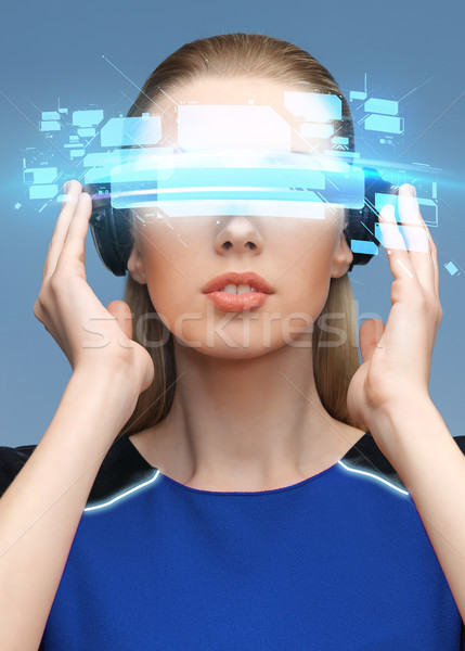 woman in virtual reality 3d glasses with screens Stock photo © dolgachov