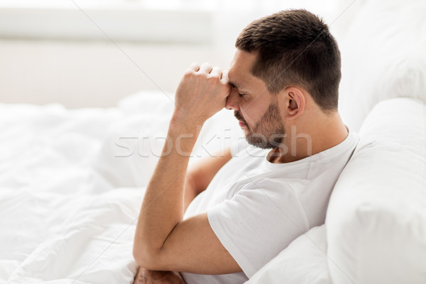 stressed man in bed at home Stock photo © dolgachov