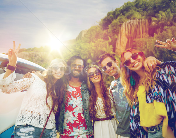 hippie friends at minivan car showing peace sign Stock photo © dolgachov