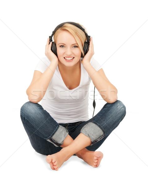 Boldog tinilány nagy fejhallgató kép nő Stock fotó © dolgachov