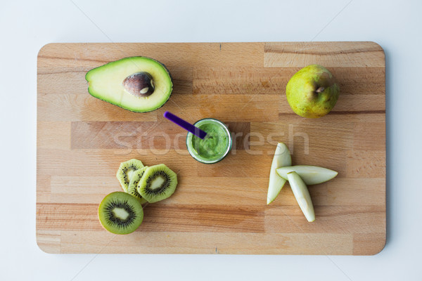 jar with fruit puree or baby food on wooden board Stock photo © dolgachov