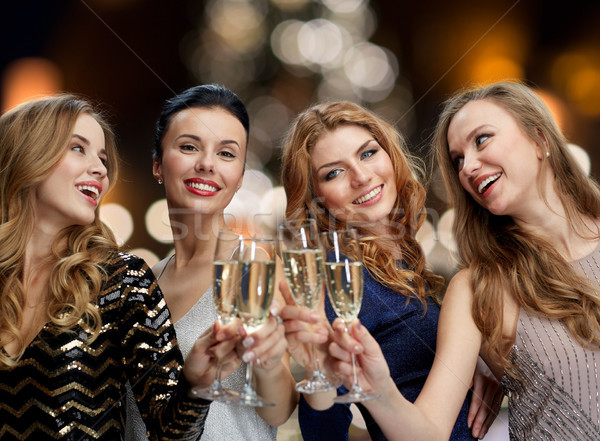 happy women drinking champagne at christmas Stock photo © dolgachov