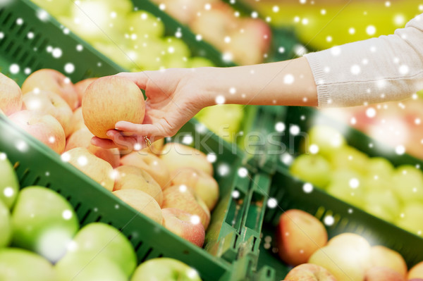 hand with apples at grocery store Stock photo © dolgachov