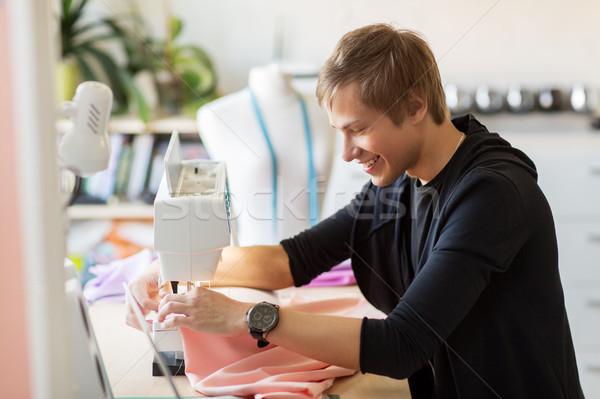 Moda tasarımcı dikiş makinesi çalışma insanlar giyim Stok fotoğraf © dolgachov