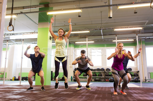 group of people exercising and jumping in gym Stock photo © dolgachov
