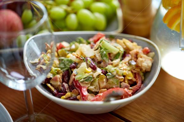 Fumado salada de frango tigela mesa de madeira comida culinária Foto stock © dolgachov