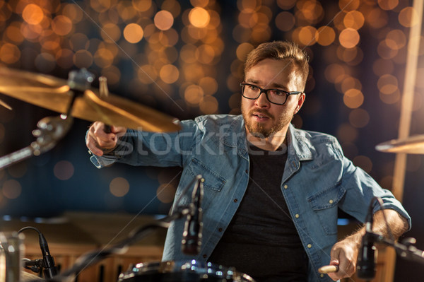 musician playing drum kit at concert over lights Stock photo © dolgachov