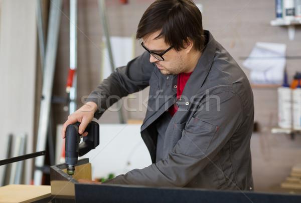 Cacciavite mobili produzione industria lavoro Foto d'archivio © dolgachov