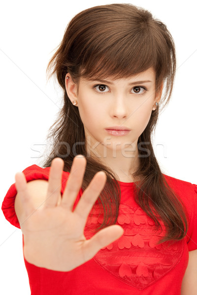teenage girl making stop gesture Stock photo © dolgachov