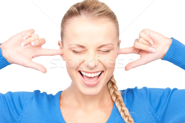 smiling woman with fingers in ears Stock photo © dolgachov