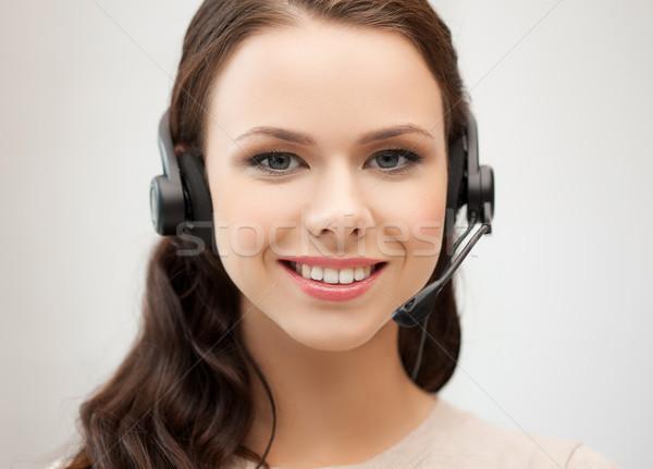 Amistoso femenino línea de ayuda operador auriculares negocios Foto stock © dolgachov