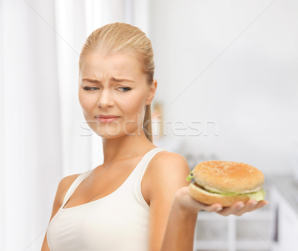 woman rejecting junk food Stock photo © dolgachov