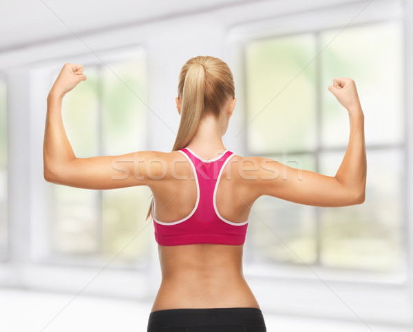 Stockfoto: Vrouw · tonen · biceps · foto · jonge
