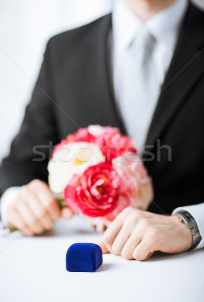 man with gift box in suit Stock photo © dolgachov