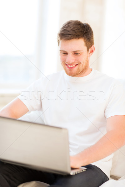man working with laptop at home Stock photo © dolgachov