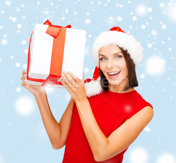 smiling woman in santa helper hat with gift box Stock photo © dolgachov