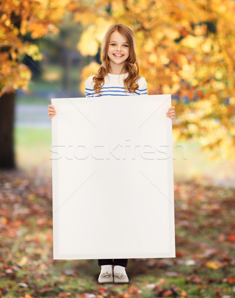 little girl with blank white board Stock photo © dolgachov