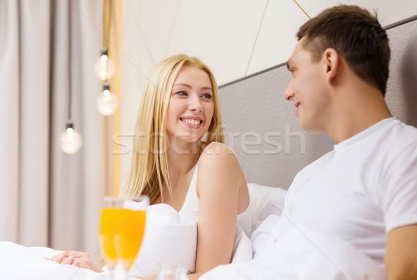 Сток-фото: улыбаясь · пару · завтрак · кровать · отель · путешествия