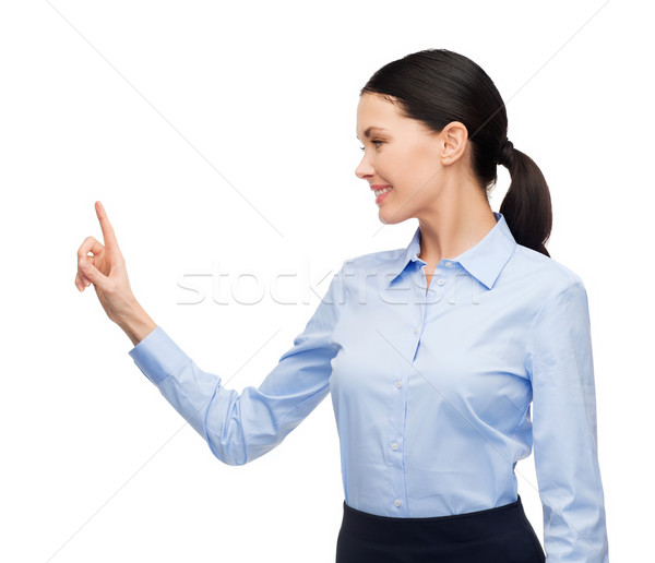 woman working with imaginary virtual screen Stock photo © dolgachov