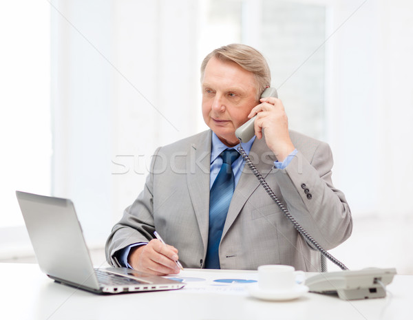 busy older businessman with laptop and telephone Stock photo © dolgachov