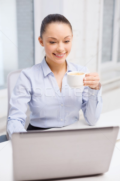 Stock photo: smiling businesswoman or student with laptop