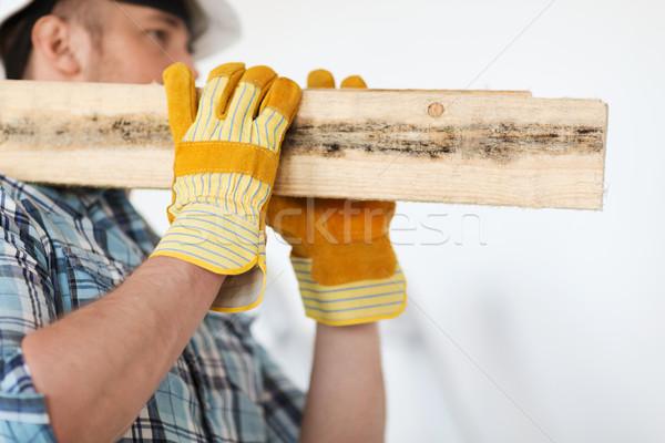 Erkek eldiven ahşap tamir Stok fotoğraf © dolgachov