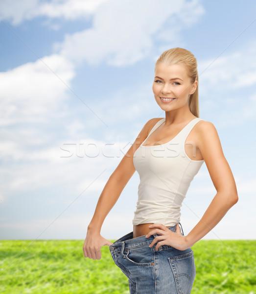 Femme grand pants fitness Photo stock © dolgachov