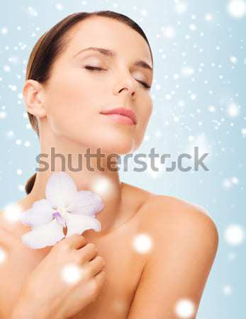 Stock photo: young woman with rose flower