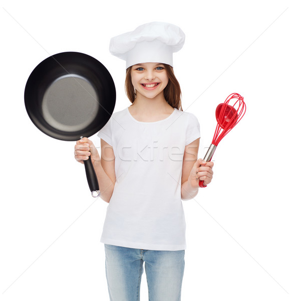 smiling girl in cook hat with ladle, whisk and pan Stock photo © dolgachov