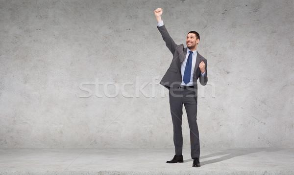 Gelukkig zakenman handen omhoog business kantoor jonge Stockfoto © dolgachov