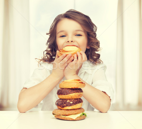 girl with junk food Stock photo © dolgachov