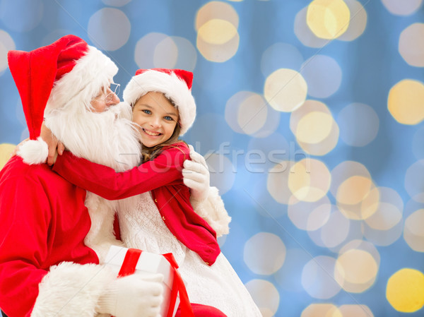 smiling little girl with santa claus Stock photo © dolgachov