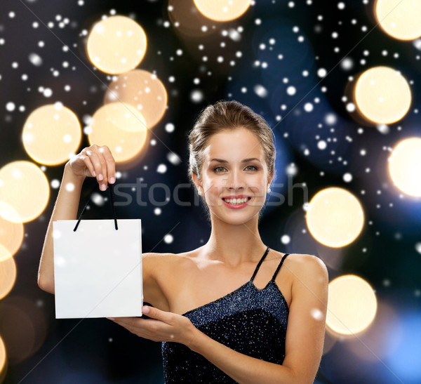 Stock photo: smiling woman with white blank shopping bag