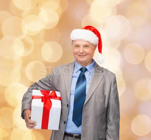 Sorridente homem terno ajudante seis Foto stock © dolgachov