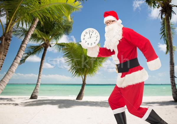 Homem traje papai noel relógio natal férias Foto stock © dolgachov