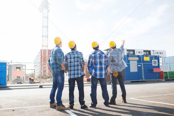 Grupo constructores aire libre negocios edificio trabajo en equipo Foto stock © dolgachov