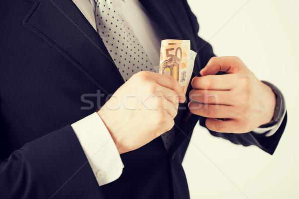 Man euro cash geld hand pak Stockfoto © dolgachov