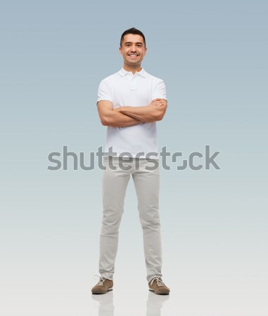Stock photo: smiling man with crossed arms