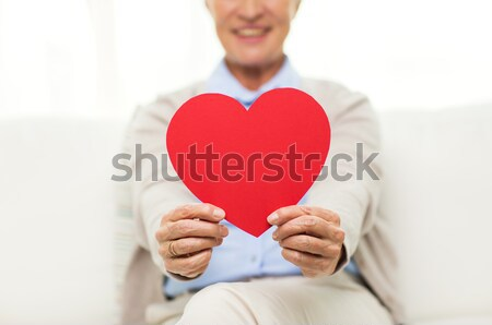 close up of happy gay male couple with red hearts Stock photo © dolgachov
