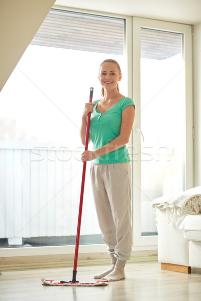 happy woman with mop cleaning floor at home Stock photo © dolgachov