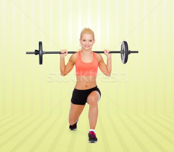 женщину штанга фитнес спорт Сток-фото © dolgachov