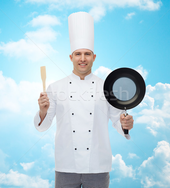 happy male chef holding frying pan and spatula Stock photo © dolgachov